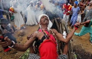 A Santero priest prays during an African-Cuban religious Santeria ceremony in honor of slaves rebelliousness, as part of the 30th Caribbean Festival in Loma del Cimarron, El Cobre, Cuba, Wednesday, July 7, 2010. The annual cultural event, that is dedicated to the Caribbean island of Curacao and the Brazilian state of Pernambuco, features religious ceremonies, street shows, concerts, conferences and art exhibits. (AP Photo/Javier Galeano)